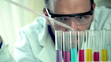 Scientist doing lab test with chemicals — 图库视频影像