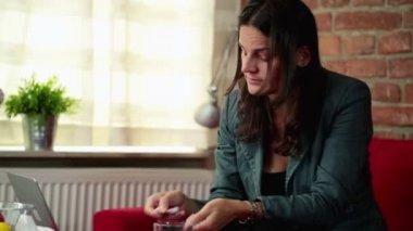 Sick woman taking pill — Stockvideo