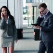 Business people with cellphone and tablet — Stock Video
