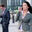 Businesswoman talking on cellphone in city — Stock Video #39762021