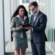 Businessman and businesswoman working with tablet — Stock Video