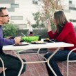 Couple eating lunch on terrace — Stock Video