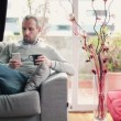 Man drinking tea and using smartphone — Stock Video #40341345