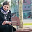 Woman using smartphone in the city — Stock Video #40341777