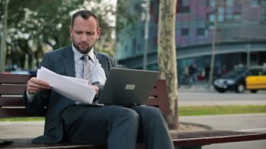 Businessman working with laptop and documents — Stock Video