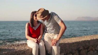 Couple meet on jetty by sea — 图库视频影像