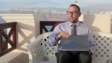 Businessman finishing work on laptop — Stock Video