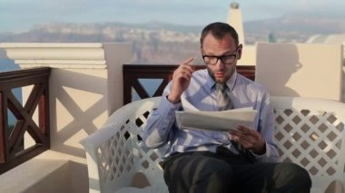 Businessman reading documents — Stock Video