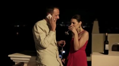 Wealthy couple with cellphone — Stock Video