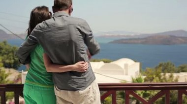 Couple hugging on hotel terrace — Stockvideo