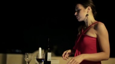 Thoughtful woman waiting and drinking wine — Stockvideo