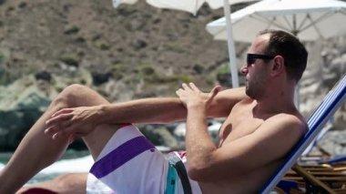 Man applying lotion on arm — Stock Video