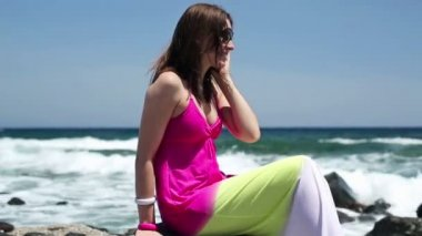 Woman talking on cellphone by sea — Wideo stockowe