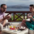 Couple with smartphone during breakfast — Stock Video #40604395