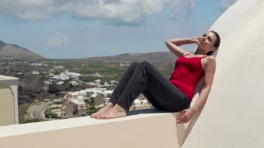 Woman relaxing on terrace — Stock Video