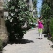 Woman walking in old city — Stock Video