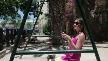 Woman on swing — Stock Video