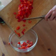 Putting chopped pepper into bowl — Stock Video #41551309