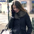 Woman talking on phone in city — Stock Video
