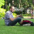 Student using tablet computer in the park — Stock Video #42617895