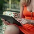 Beautiful woman with tablet computer — Stock Video