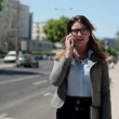 Businesswoman talking on mobile phone — Stock Video