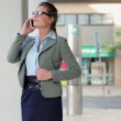 Businesswoman talking on mobile phone — Stock Video #42621381