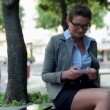 Businesswoman with smartphone in the city — Stock Video