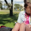 Female student studying in park — Stock Video #42623541