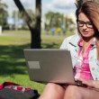 Female student with laptop in park — Stock Video #42623577