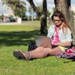 Female student with laptop in park — Stock Video #42623661