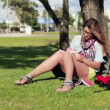 Female student studying in park — Stock Video #42624041