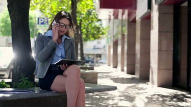 Businesswoman with tablet and cellphone — Stockvideo