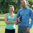 Sporty couple standing in park — Stock Video
