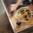 Woman adding spices and tasting salad — Stock Video #43693193