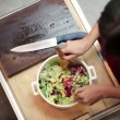 Woman mixing vegetable salad — Stock Video #43693955