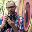Hipster taking photo with retro camera — Stock Video