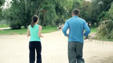 Couple jogging in park — Stock Video