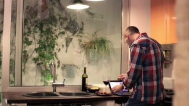 Man browsing on tablet and drinking wine — Stock Video