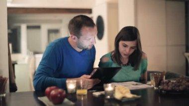 Couple calculating bills — Stock Video
