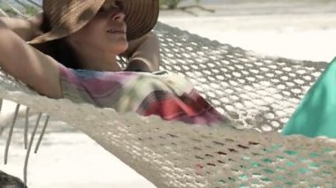 Young happy woman lying, relaxing on hammock — Stock Video