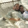 Couple relaxing on hammock — Stock Video #45218061
