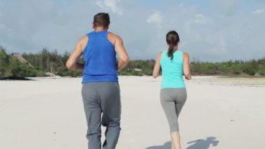 Couple jogging on beach — Stock Video