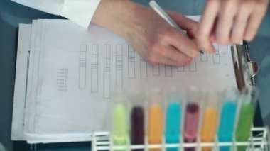 Scientist checking test tubes — Stock Video