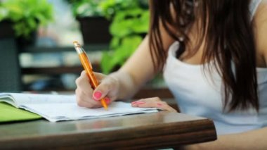 Student doing homework in cafe — Stok video
