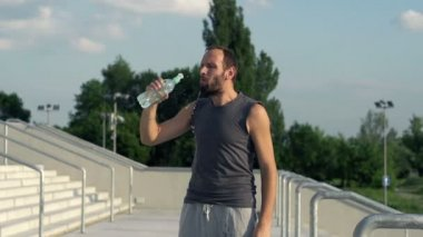 Jogger drinking water after run — Vidéo