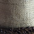 Stock Photo: Coffee beans and jute fibers background texture