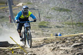 """GRANADA, SPAIN - JUNE 30: Unknown racer on the competition of the mountain downhill bike """"Bull bikes Cup DH 2013, Sierra Nevada """" on June 30, 2013 in Granada, Spain — Stock Photo"""
