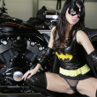 Stock Photo: Bat babe with bike