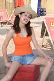 Bikini babe in a beach club — Stock Photo